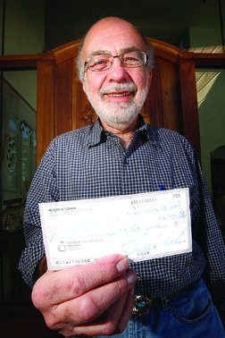 Roger Cohen is prominently displaying his tentative $5,000 check.